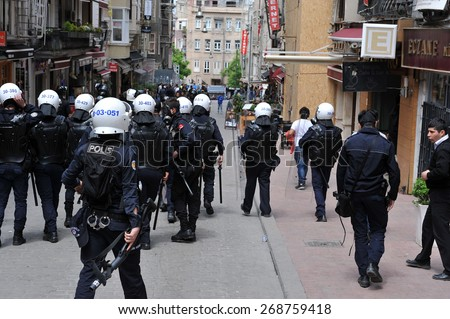 ISTANBUL - MAY 1: Many people can't take part in May Day march on May 1, 2014 in Istanbul. Police blocked all the ways to Taksim Square to prevent activists from joining their mates.