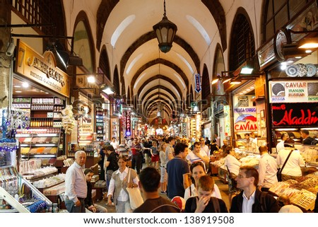 ISTANBUL, May1: People shopping in the Grand Bazar in Istanbul, Turkey, one of the largest covered markets in the world, Istanbul, May 1, 2013 - stock photo