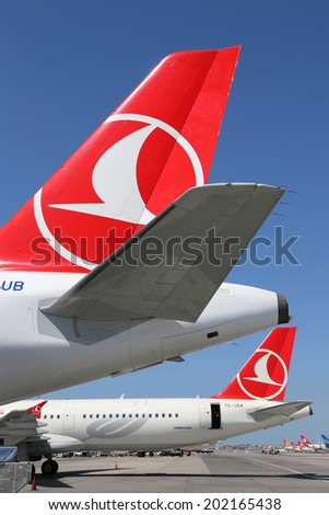 ISTANBUL - MAY 15: Tails of Turkish Airlines airplanes on May 15, 2014 in Istanbul. Turkish Airlines is the largest airline of Turkey with its headquarters in Istanbul. - stock photo