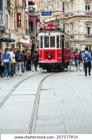 ISTANBUL - MAY 07 : Taksim Istiklal Street at eventide on May 07, 2014 in Istanbul, Turkey. Taksim Istiklal Street is a popular tourist destination in Istanbul.