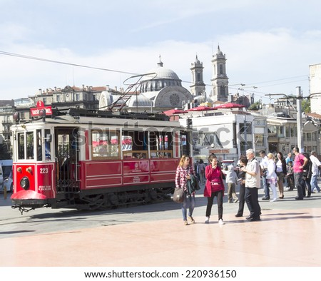 ISTANBUL - MAY 03 : Taksim Istiklal Street at eventide on May 03, 2014 in Istanbul, Turkey. Taksim Istiklal Street is a popular tourist destination in Istanbul. - stock photo