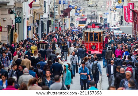 ISTANBUL - MAY 07 : Taksim Istiklal Street at eventide on May 07, 2014 in Istanbul, Turkey. Taksim Istiklal Street is a popular tourist destination in Istanbul.  - stock photo