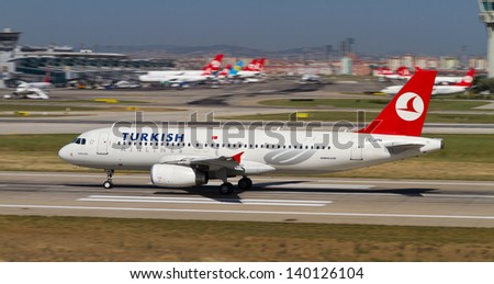 ISTANBUL - MAY 26: Turkish Airlines Airbus A320-232 accelerate to takeoff at Ataturk Airport on May 26, 2013 in Istanbul, Turkey. TA is named the Best Airline in Europe 2012 World Airline Awards. - stock photo