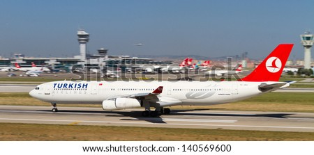 ISTANBUL - MAY 26: Turkish Airlines Airbus A340-311 accelerate to takeoff at Ataturk Airport on May 26, 2013 in Istanbul, Turkey. TA has the worlds fourth largest flight network with 100 countries. - stock photo