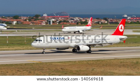 ISTANBUL - MAY 26: Turkish Airlines Airbus A321-231 accelerate to takeoff at Ataturk Airport on May 26, 2013 in Istanbul, Turkey. TA is the national flag carrier airline of Turkey. - stock photo