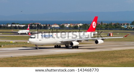ISTANBUL - MAY 26: Turkish Airlines Airbus A340-311 accelerate to takeoff at Ataturk Airport on May 26, 2013 in Istanbul, Turkey. Airbus A340 introduced in 1993, has 440 maximum seating capacity. - stock photo