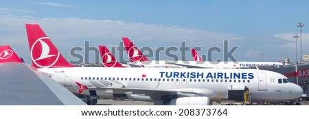 ISTANBUL - MAY 2, 2014: Turkish airlines planes on the Ataturk international airport In 2014, Turkish Airlines has been chosen for the fourth time in a row as the best airline in Europe