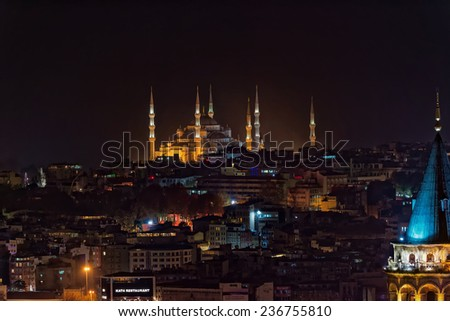 ISTANBUL, NOV 13: Blue mosque during night from the Marmara district with the Galata tower in the foreground. November 2013 in Istanbul, Turkey  - stock photo