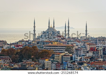 ISTANBUL - NOV 21: Blue mosque with resedential area and the Bosporus with tankers in background. November 21, 2013 in Istanbul, Turkey. - stock photo