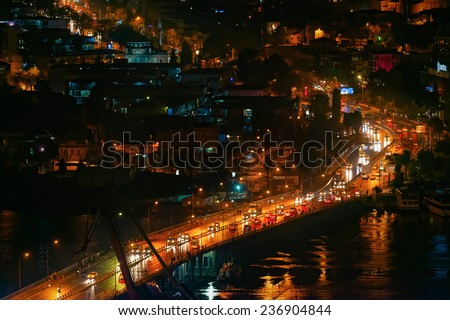 ISTANBUL, NOV 13: Traffic over the Unkapani bridge or Ataturk bridge during night time in Istanbul. November 2013 in Istanbul, Turkey  - stock photo
