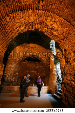 ISTANBUL - NOVEMBER 3: Tourists at interior of the Byzantine Cistern in Sultanahmet on November 3, 2009 in Istanbul, Turkey.  - stock photo