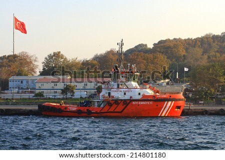 ISTANBUL - OCT 30, 2013: Coast guard boat KIYI EMNIYETI berthed in port. An escort board is compulsory in straits for all the tankers over 249,99 meters - stock photo