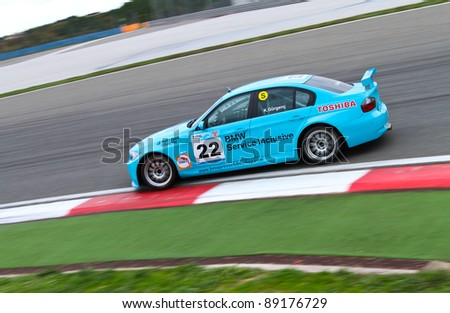 ISTANBUL - OCTOBER 29: Kaan Gurgenc drives a BMW 320 SI car during Turkey  Track Championship on October 29, 2011 in Istanbul, Turkey - stock photo