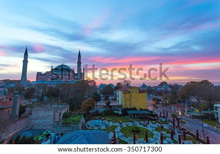 Istanbul Old City Morning View with street cafe and famous Sophia Cathedral with amazing luminous colors of morning sky - stock photo