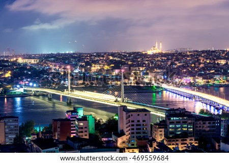ISTANBUL - SEPTEMBER 2014: Panoramic aerial view at night. Istanbul attracts 10 million people annually.
