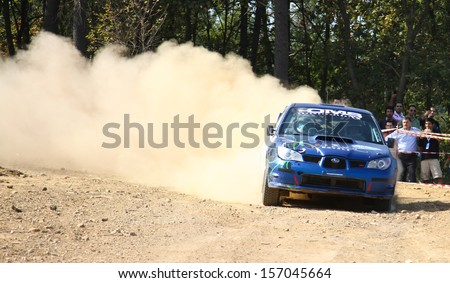 ISTANBUL - SEPTEMBER 29: Sabri Unver drives Subaru Impreza in 42nd Bosphorus Rally Mudarli Stage on September 29, 2013 in Istanbul, Turkey. - stock photo