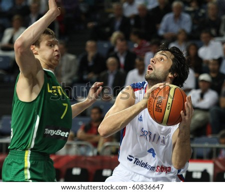 ISTANBUL - SEPTEMBER 12: Serbia's Milos Teodosic drives to the basket in FIBA World Championship game between Serbia and LIthuania on September 12, 2010 in Istanbul