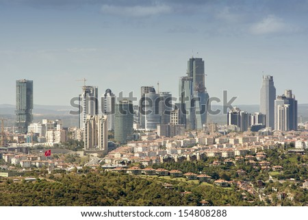 ISTANBUL, September 4: Skyscrapers and residences can be seen in Zincirlikuyu; one of the most populated financial districts of Istanbul, Turkey in September 4, 2013. - stock photo