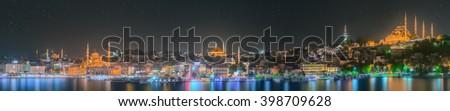Istanbul skyline from Galata bridge by night - stock photo