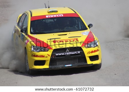 ISTANBUL, TURKEY - APRIL 17: Alex Raschi drives a Pirelli StarDriver Team Mitsubishi Lancer Evo5 car during Rally of Turkey 2010 WRC championship, Ulupelit Stage on April 17, 2010 in Istanbul, Turkey
