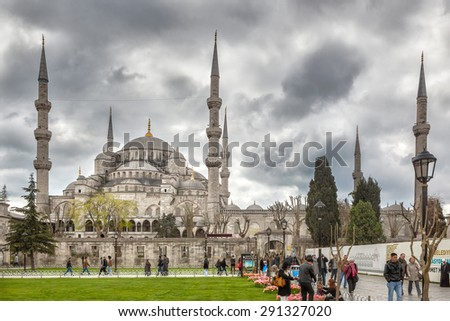 ISTANBUL, TURKEY - April 20: Blue mosque dome and minarets under heavy sky with tourists and locals shown on 20 April 2013 in Istanbul, Turkey. Image is panorama with spherical projection. - stock photo
