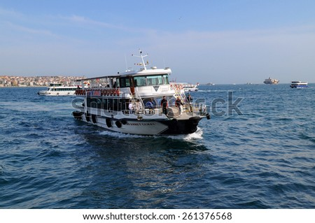ISTANBUL, TURKEY - APRIL 30, 2012: Boat with passengers arrives at the European side of Istanbul from its Asian side after crossing the Bosphorus  - stock photo