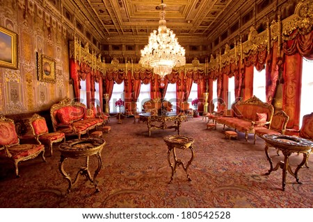 ISTANBUL, TURKEY - April 1, 2013 - Dolmabahce Palace: interior: furniture was from Paris, vases from Sevr, canslesticks from England; silk handmade carpets are from royal workshop in Hereke.  - stock photo
