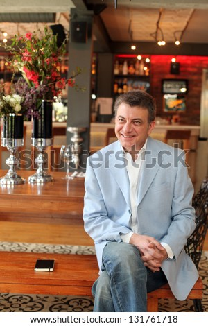 ISTANBUL, TURKEY - APRIL 16: Famous Turkish writer Kursat Basar at book promotion press meeting on April 16, 2012 in Istanbul, Turkey. Kursat Basar, Turkey's best selling romantics books writer. - stock photo