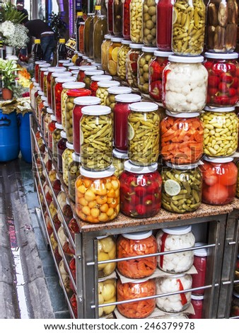 Istanbul, Turkey. April 28, 2011. Glass jars with tinned pickles and marinades on a counter of the market