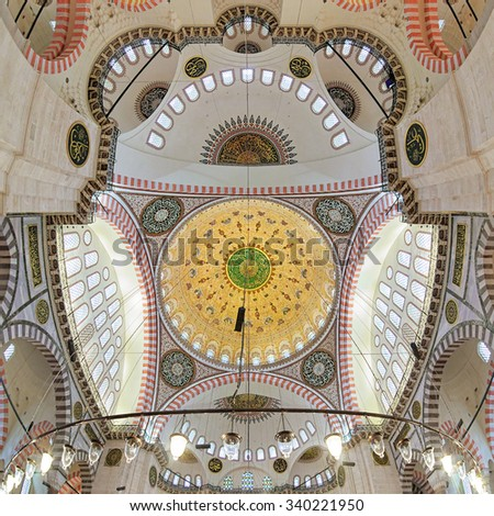ISTANBUL, TURKEY - APRIL 4, 2011: Inner dome and ceiling painting of Suleymaniye Mosque. This largest mosque of Istanbul was built in 1550-1580 by design of the chief Ottoman architect Mimar Sinan. - stock photo