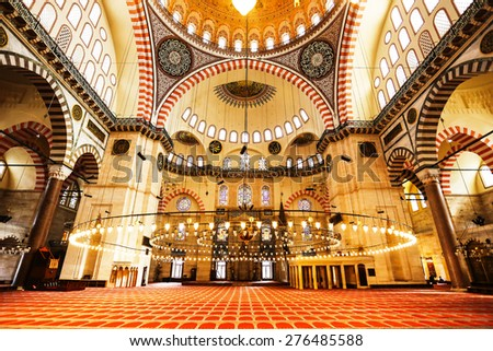 ISTANBUL, TURKEY - APRIL 10, 2014: Interior of Suleymaniye Mosque. This largest mosque of Istanbul was built in 1550-1580 by design of the chief Ottoman architect Mimar Sinan. - stock photo