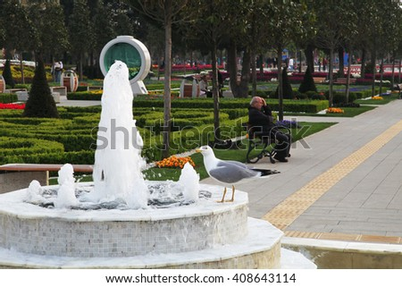ISTANBUL, TURKEY - APRIL 4: Old man resting at the Goztepe Park on April 4, 2014 in Istanbul, Turkey. - stock photo