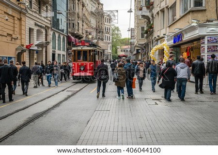 Istanbul, Turkey - April 08, 2016: People are walking down the Istiklal street near the  red tramway in Istanbul, Turkey