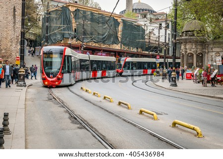 Istanbul, Turkey - April 08, 2016: People are walking in the streets of Istanbul while tram is passing by