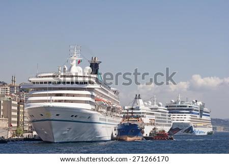 ISTANBUL, TURKEY, APRIL 21, 2014: Touristic cruise ships docked on Karakoy Port, Karakoy is today a major transport hub for intercity and international passenger traffic. - stock photo