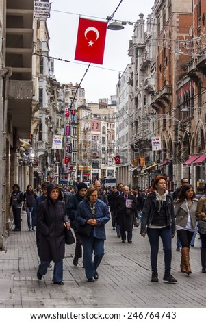 Istanbul, Turkey. April 28, 2011. Typical city landscape. Citizens and tourists go across Istiklyal, the main street of Istanbul