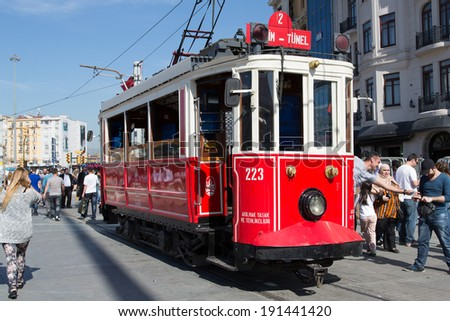 ISTANBUL, TURKEY - April 28: Vintage tram on the Taksim Street on April 28, 2013 in Istanbul, Turkey. Nostalgic tram of Istanbul is the heritage tramway system. It was re-established in 1990.