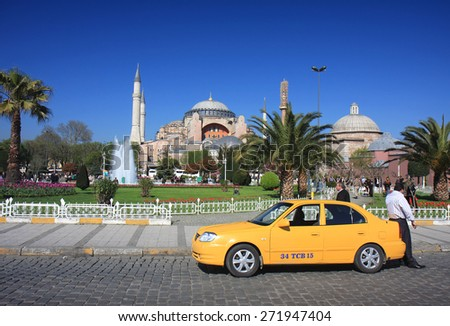ISTANBUL,TURKEY-APRIL 8:Yellow Cab driver waiting customer near World Famous Byzantine Church Hagia Sophia at Sultanahmet Park.April 8,2008 in Istanbul,Turkey. - stock photo