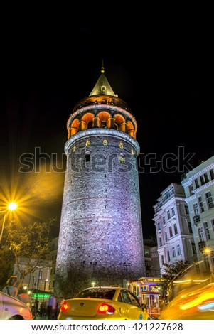 ISTANBUL, TURKEY - APRRIL 16, 2016: Night view over illuminated galata tower with cars blur in Istanbul, Turkey. The Galata Tower (Galata Kulesi)  is a medieval stone tower in the Karakoy quarter.