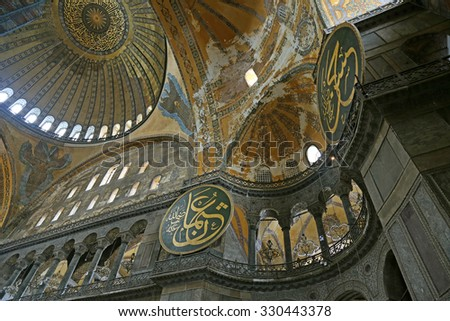 ISTANBUL, TURKEY - AUGUST 07, 2015: A view of the vaulted interior of Hagia Sophia, located in Istanbul, Turkey.  It was constructed in 537 by Byzantine Emperor Justinian I.  - stock photo