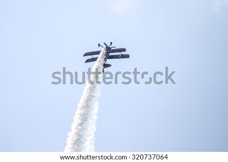 ISTANBUL, TURKEY - AUGUST 02, 2015: Ali Ismet Ozturk piloting his special biplane called Purple Violet at the TATCA Airfest 2015