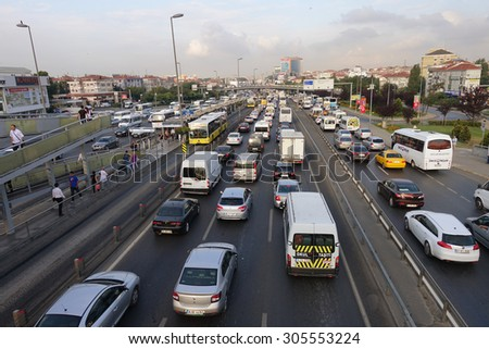 ISTANBUL, TURKEY- AUGUST 11, 2015: Bahcelievler district in istanbul Metrobus, a part of public transportation system, eases the traffic in Istanbul on AUGUST 11, 2015 in Istanbul, Turkey - stock photo