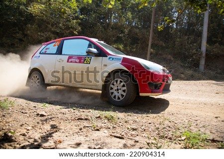ISTANBUL, TURKEY - AUGUST 16, 2014: Can Altinok drives Ford Fiesta ST car in Avis Bosphorus Rally, Deniz Stage