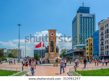 ISTANBUL, TURKEY, AUGUST 22, 2014: Dozens of people are strolling around Taksim square, which became famous because of recent protests against government.