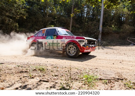 ISTANBUL, TURKEY - AUGUST 16, 2014: Engin Kap drives Ford Escort MKII car of Bonus Unifree Parkur Racing Team in Avis Bosphorus Rally, Deniz Stage
