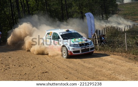ISTANBUL, TURKEY - AUGUST 16, 2014: Murat Soycopur drives Fiat Punto S1600 car of Pegasus Racing Team in Avis Bosphorus Rally, Mudarli Stage - stock photo