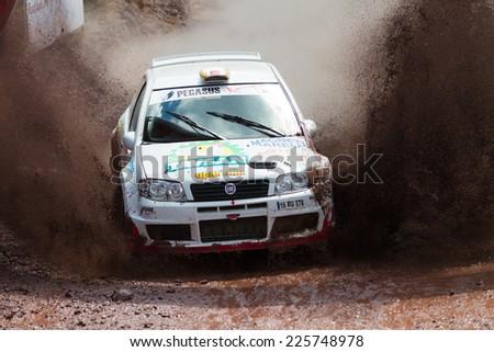 ISTANBUL, TURKEY - AUGUST 17, 2014: Murat Soycopur drives Fiat Punto S1600 car of Pegasus Racing Team in Avis Bosphorus Rally, Gocbeyli Stage - stock photo