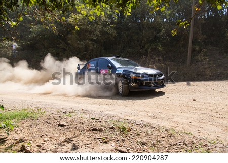 ISTANBUL, TURKEY - AUGUST 16, 2014: Nebil Erbil drives Mitsubishi Lancer Evo IX car of Tok Sport WRT in Avis Bosphorus Rally, Deniz Stage