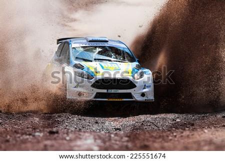 ISTANBUL, TURKEY - AUGUST 17, 2014: Oleksandr Saliuk drives Ford Fiesta R5 car in Avis Bosphorus Rally, Gocbeyli Stage - stock photo