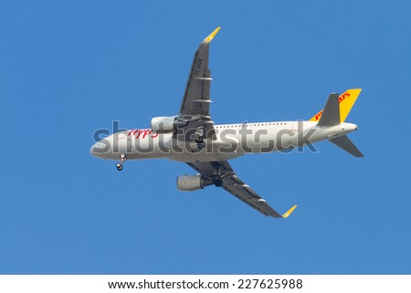 ISTANBUL, TURKEY - AUGUST 17, 2014: Pegasus Airlines Airbus A320-214 landing to Sabiha Gokcen Airport. Pegasus is the second largest airlines in Turkey with 54 airplanes. - stock photo